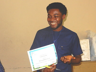 Alah Emmanuel Akomaye smiles upon receiving his diploma and prize