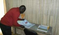 Aliou Sall selecting visual teaching aids
