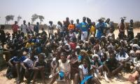 The group photo of the pupils after the beach clean-up